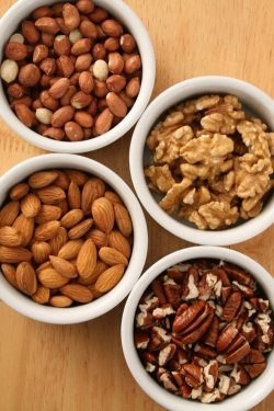 Aww Nuts! Nuts and seeds are concentrated sources of protein, fats, B vitamins, vitamin E, iron, magnesium and other minerals. Some of them contain omega 3 fatty acids and as such can help to improve the balance of cholesterol and the blood lipid profile and reduce the risk of heart disease. Some people have difficulty digesting nuts and seeds and in this case, soaking them overnight initiates the sprouting process and improves digestibility. They are best consumed in limited amounts if weight loss is desired or if digestive difficulties are present, however in these situations the nuts and seeds rich in omega 3 fatty acids (flaxseed, walnut, chia and pumpkin seed) may be beneficial as these fats can actually improve metabolism. Almonds are very high in minerals including calcium, magnesium, potassium and iron and are the only nut that is alkaline forming in the body. According to Ayurvedic medicine, almonds nourish the vital energy of the body.Almonds are also thought to contain a compound that is anti-carcinogenic and for this purpose it is recommended that six almonds are consumed daily. Brazil nuts are rich in the sulfur containing amino acids and selenium. Selenium has an important function as an antioxidant and is involved in immunity. Flaxseeds are the richest source of omega 3 fatty acids and thus help to improve immunity and reduce high cholesterol. When taken in the form of flaxseed meal they effectively prevent constipation and are a source of lignans – compounds that have antitumour and antioxidant properties. Flaxseeds also help to balance estrogen levels. Hazelnuts are very rich in calcium, magnesium, iron, potassium, phosphorus, folic acid and vitamin E. Hazelnuts act as a general tonic and strengthen the stomach. Macadamia nuts are very high in fat and can contribute to weight gain if consumed in excess. However in moderation they can help to improve the balance of cholesterol due to their abundance of monounsaturated fats. They are also very low in carbohydrates and as such are suitable for low carb diets. Pistachio nuts are considered a tonic for the whole body in Ayurvedic medicine. They purify the blood, lubricate the intestines and can be used for constipation. Pumpkin seeds are known for their effects against intestinal parasites especially roundworm and tapeworm. Their high zinc content may explain the value pumpkin seeds for the treatment of impotence and prostate enlargement.Pumpkin seeds are also a valuable source of omega 3 fatty acids. Sesame seeds are very high in calcium and are a good source of magnesium, niacin, vitamins A and E, protein and unsaturated fats. In the form of tahini (sesame seed paste) they provide the richest and most bioavailable source of calcium. Sunflower seeds are high in protein, unsaturated fats, phosphorus, calcium, iron, fluorine, iodine, potassium, magnesium, zinc, B vitamins, and vitamin E and are one of the rare plant sources of vitamin D. Walnuts are high in protein, iron and contain omega 3 fatty acids. They can reduce inflammation and pain, lubricate the lungs and intestines, and nourish the brain and adrenal glands.