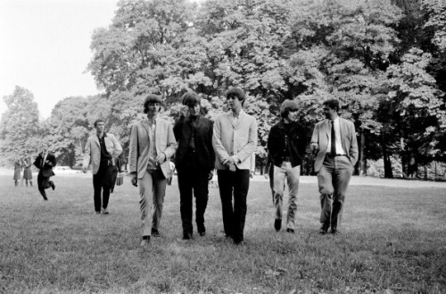 The Beatles strolling in a Paris park in June 1965