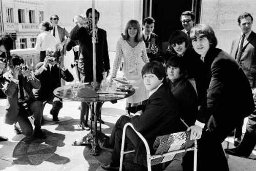 The Beatles at their Paris hotel on June 20, 1965 in Paris.