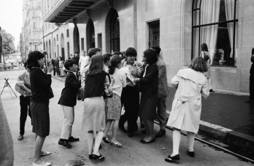 Paul McCartney with fans in front of his hotel in June, 1965 in Paris, France.
