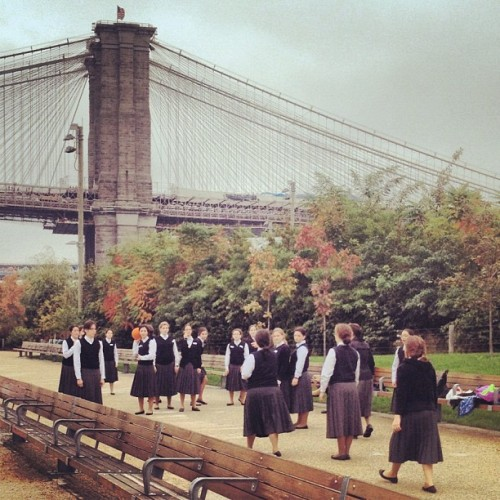 Only in New York. (A group of orthodox Jewish schoolgirls playing dodgeball against the backdrop of two bridges.) (at Brooklyn Bridge Promenade)