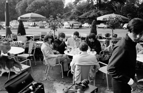 The Beatles having drink on the terrace of a cafe in June, 1965.