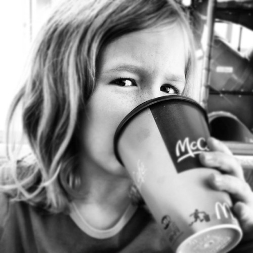 She was not impressed with McD's spanish translation on the hot chocolate. (at McDonald's)