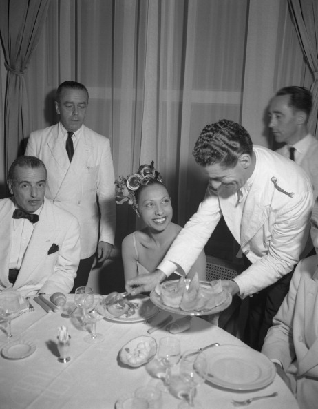 vintageblackglamour:  43-year-old Josephine Baker is being served prosciutto & melon in Venice in 1949.  Today (October 25) is my 43rd birthday and to celebrate, I thought I would post photos of some of my favorite VBG legends at the age of 43. Sadly, too many did not make it to 43 (Dorothy Dandridge, Dinah Washington, Diana Sands, Lorraine Hansberry) but many did and did it well. Photo by Archivio Cameraphoto Epoche/Getty Images.