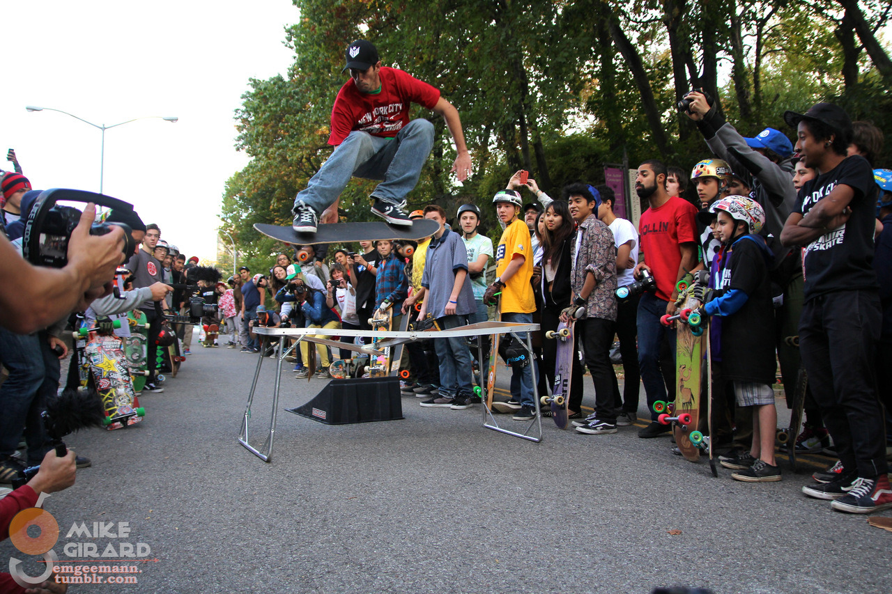 Yoni Ettinger: BOSS status. Lien 180 over a table. Earthwing Skate for Life Slide Jam - Harlem, NYC. Photo: Mike Girard