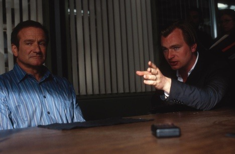 "Director Christopher Nolan with Robin Williams on the set of the 2002 remake of ""Insomnia"""