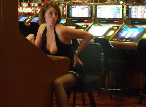 I sit down to gamble and look over and this horny girl pull her tit out.