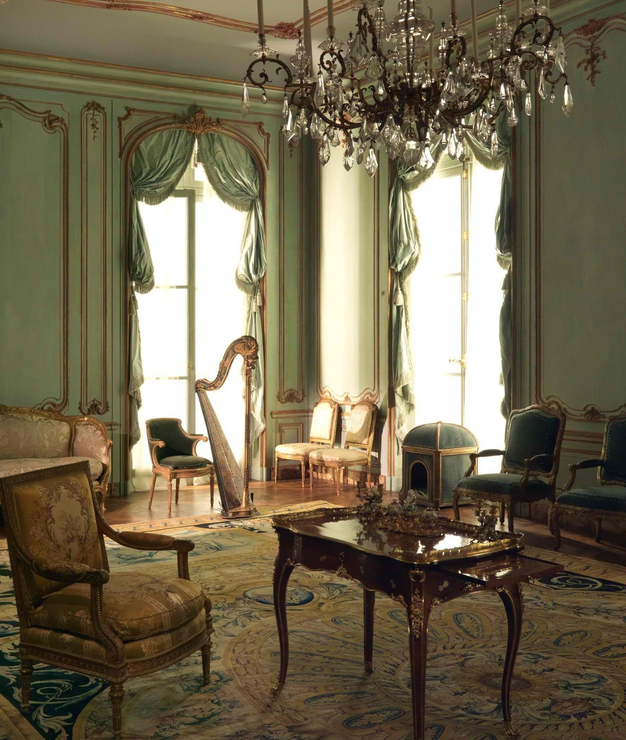 The  Palais Paar  room (Wrightsman Galleries  , the Metropolitan Museum of Art)  A testimony to the widespread influence of French eighteenth-century styles is the  Palais Paar paneling, created in about 1765–72  in Vienna. Displaying triple moldings enriched with foliate and shell motifs and flowers, the  paneling is executed in a French late Rococo style. This large, formal room features one of the famous Savonnerie carpets created during the late seventeenth century for the  Louvre Palace. Among the furnishings is  one of the famous  Savonnerie carpets created during the late seventeenth century for the  Louvre Palace, gilt bronze, Sèvres porcelain, silver, and gold boxes, a wall clock in gilt bronze by Charles Cressent, as well as seat furniture made for the gaming rooms of two French royal palaces.
