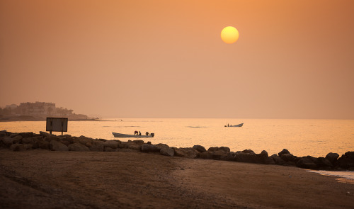 Fishermen at sunset. Muscat, Oman.