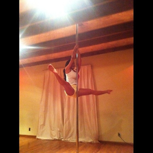Rosa Acosta taking some pole lessons.