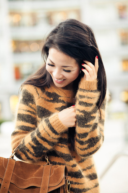 I'm not usually into animal print, but I kinda love this sweater. #fashion Source: Wendy's Lookbook