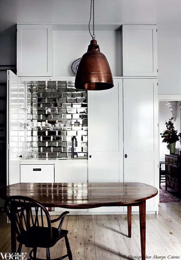 voguelivingmagazine:  A splashback made from mirror bevelled tiles brings a touch of glamour to this Melbourne kitchen. From 'Mirror Finish', a story on page 184 of Vogue Living Sept/Oct 2012. Photograph by Sharyn Cairns.