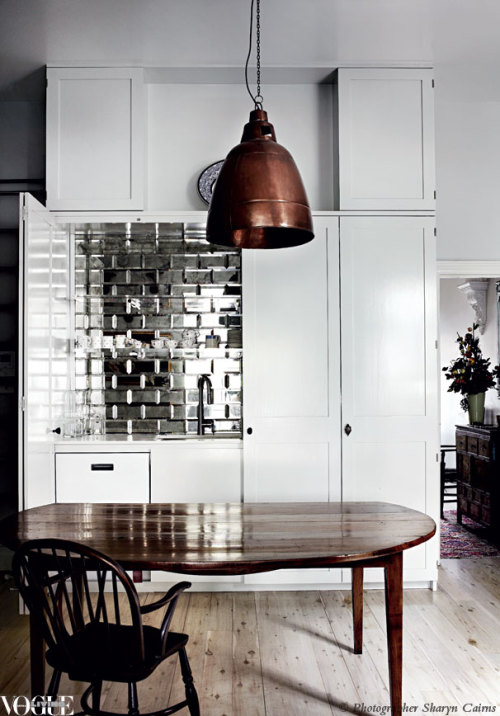 A splashback made from mirror bevelled tiles brings a touch of glamour to this Melbourne kitchen. From 'Mirror Finish', a story on page 184 of Vogue Living Sept/Oct 2012. Photograph by Sharyn Cairns.