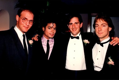"Bill Branca, Michael Jackson, David Goldman, John Branca Cirque du Soleil with Michael Jackson ""So back in the mid 90's, I had the pleasure of hanging out with Michael Jackson at the recording studio. Teddy Riley was producing a track on Michael's album; I knew Teddy through my client Martin Lawrence and Teddy's manager Harvey Elkin invited me to the studio for a recording session. I walked in and there was Michael Jackson standing in the corner, Harvey took me to Michael and introduced me, however, I reminded Michael that we met a few years earlier at my brothers wedding in Beverly Hills, Ca. Yes, he then remembered me and invited me to have dinner with them at the studio. Michael was also very impressed that I was John Branca's brother. Michael was very fond of my brother and my brother was Michaels Attorney for the better part of the 80's and represented Michael through the height of his career. Michael was then very curious on what I did, and I told him I was a Talent Agent and represented young comedians. Michael was fascinated, and when I told him I represented Martin Lawrence, Chris Rock, Tommy Davidson, Russell Simmons Def Comedy Jam, he was blown away. He was a very big fan of Tommy Davison, he remembered Tommy from In Living Color, and Tommy would do a parody of Michael Jackson on the Television Show, I remember Michael saying he enjoyed watching Tommy Davidson imitating himself, Michael, took it very well, and was quite amused. Michael even asked me if I could take him to the Comedy Store on Sunset blvd, so he can see Tommy Davidson live and meet him. I told Michael that I would set it up and we can sneak him in through the kitchen a make a night of it. Michael went on and asked me many questions about my life, my family, my childhood, my family.Michael was very interested in my life, and my routine, my career. I was taken back somewhat, here I am having dinner with this ICON, this person who is larger then life, and he was so very interested in my life, my career, and my childhood, and my family. After our dinner, Michael asked if I would like to watch a movie with him, of course I would what did you have on VHS, Michael said he loved the movie, Teenage Mutant Ninja Turtles, I told Michael I never saw it and I would love to watch it with him. So Harvey Elkin, put the video into the VHS player and we watched the entire movie. Teddy had left to go back into the studio to listen to the sound tracks, Harvey was cleaning up the table after dinner and Michael Jackson and I sat in front of the TV and enjoyed the movie. After the movie, it was after midnight, I felt that I should be going. I said goodbye to Michael and thanked him for his hospitality. Michael made it a point for me to tell my brother to call him; he had not spoken to him in a wile and had some new business to discuss with him. The next day I called my brother, John and shared with him the very surreal evening I had the night before with Michael Jackson… My brother ended up calling Michael a few days later, and sure enough they reconnected on some new projects. Michael then, called my brother a few weeks later, invited him to Cirque du Soleil, and asked my brother to invite me to join them. I could invite a friend to come along, so I really did not have a girl in my life worthy enough to take, so I invited my best friend and business partner, Worthy Patterson. It was quite a trip! We met Michael in his condominium in West wood. My brother went inside to get Michael and Worthy and I waited in the car, I was thinking that Michael would ride with us to Santa Monica. My brother came outside alone and told me that Michael was getting his car, and that my brother was going to drive with Michael, and we would follow. My brother then gave me the keys to this Cornice Rolls Royce and I followed Michael Jackson, who by the way was driving a tricked out customized Van. I remember following Michael down Wilshire Blvd to Santa Monica, Ca. Let me say this, it was a hell of a ride keeping up with Michael, That boy can drive, unfortunately not very well. However, I was very impressed; it was just Michael Jackson and my brother in the Van, no security detail, with me and Worthy ""trying"" to follow them. And keep up… I distinctly, remember pulling up back stage at Cirque du Soleil, and there was security detail waiting for Michael, they waved him through and stopped me in the Cornice Rolls Royce. Michael stopped the van and very quickly told the security ""they are with me let them in"" and to let us through. We parked next to Michael, an army of security escorted us into the show, Michael put on some sort of mask with a wig to cover his face, he then removed it when we were seated. They had the first row sectioned off, reserved for us. It was Michael, my brother, Worthy Patterson and me. Michael removed the costume, as soon as we sat down, it was dark and the show just started… I was expecting others to join us; however, no one did! It was just us. After the show, I remember, Michael was recognized, and many fans coming up front asking him to sign autographs, he graciously signed every autographic from his fans, and we were then escorted and given a behind the scenes tour of the performers tent. It started to get a bit crazy, with the fans and everything, and we knew it was time for us to go. Michael had put some sort of disguise on and the security hid him as he got back into the van with my brother, the windows were darkened and the van drove out first. Nobody suspected Michael was in the van, however, everybody thought Michael was in the Rolls Royce, and we had some trouble exiting the parking lot. Michael was well ahead of us however, he pulled over to the side and waited for us to catch up and we followed him back to his Condo in Westwood, Ca. I remember, he drove straight into the underground parking and I waited outside for my brother to come out. Unfortunately, I did not have a chance to say goodbye to Michael, however my brother told me that Michael enjoyed our company and thank us for joining him.I feel sad because I lost touch with Michael Jackson and was not able to invite him to The Comedy Store to meet Tommy Davidson. My other client Martin Lawrence started his ""You So Crazy"" tour just after that and I produced the Tour. Moreover, I was on the road with Martin Lawrence for the majority of 18 months. That was the last time I saw Michael Jackson at the Cirque du Soleil, in Santa Monica, Ca in the mid 90's. I will always remember that Saturday afternoon."""