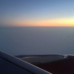 Rising #sun, #clouds below: an obligatory #plane #wing shot. #nofilter