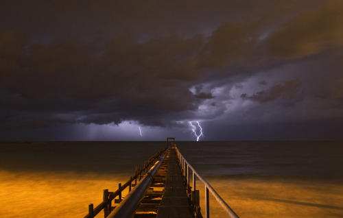 Photo of the Day: Lightning strikes over a pier during a storm in Atlit, near the northern Israeli city of Haifa. (Photo: REUTERS/Baz Ratner)