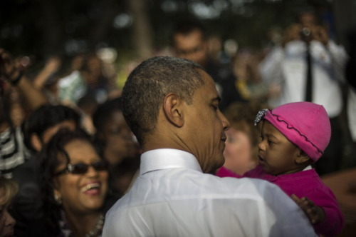 Obama gets up close and personal with a concerned citizen photo: Getty Images