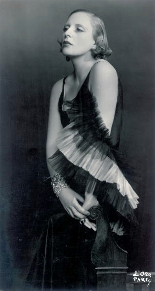Artist Tamara de Lempicka, in a dress by Marcel Rochas, photographed by Madame D'Ora (Dora Kallmus), around 1931 in Paris.