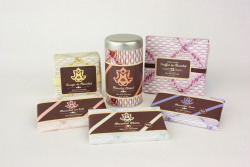 "Challenge: Design a chocolate companies identity, products, and packaging to appeal to a demographic of choice, based on a random name given. Solution: I was given the name Mon Ami Chocolat, which is french for My Friend Chocolate. I started thinking about the type of person who would have chocolate as their friend. I think this person would be a woman, single, horrible luck with relationships. She would be 25-40, a job, but no high-end education. She would probably hang out in bookstores, read a lot of romance novels, and have pet cats. This person is into comfort and doesn't socialize much. I would think that their dream would be to live in a french romance fantasy, gorgeous and feminine. So I based my company and product design off of that description, going with a french theme. I made the product kind of dreamy and decadent like, but not so much that it didn't seem unattainable to this shy woman. The logo is very rococo inspired, but includes a cat as a representation of the ""friend"". Logo and ""M"" Letter form by: Terra Miller  Photo's by: Kayley Kirmse"