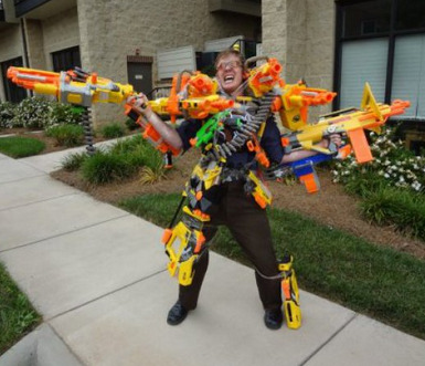 collegehumor:  Halloween Costume Decked Out With Guns Yippee-ki-yay, trick-or-treaters.  MY DREEEAAAM!!!