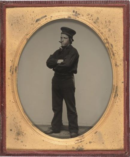 ca. 1858, [ambrotype portrait of a tough looking sailor with a cigar in his mouth and a knife in his belt] via the San Francisco Museum of Modern Art