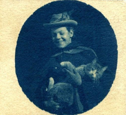 ca. 1893, [cyanotype portrait of a smiling Florence Luscomb, holding her cat Needles] via the Harvard University Libraries, Schlesinger Library on the History of Women in America, Radcliffe Institute