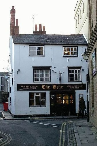 "The Bear, Oxford: ""After you get your hands around a pint, the first thing you notice are the horde of club tie snippets hanging from the walls and ceilings. And it's not hundreds, it's thousands. Started in 1952 by the landlord, Alan Course, and given by patrons (some famous) in exchange for half a pint of beer, the collection numbers northwards of 4,500 ties…ties mostly signifing membership of clubs, sports teams, schools, and colleges. You have to see them up close in person to truly appreciate the scope of it. And if you do make it into The Bear, don't forget your club tie."" — Unabashedly Prep"