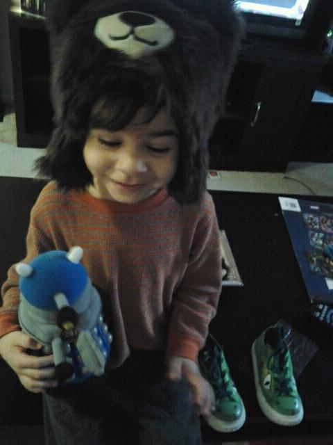Diego really enjoys his new fluffy bear hat and blue Dalek. Guess who's gunna be dressed up as the Tenth Doctor for Halloween?  That cute lil guy.
