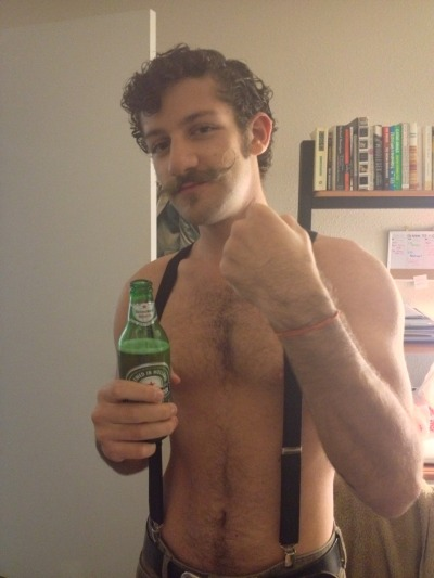 moustachioedstranger:  Halloween costume! (Heineken handlebar Moustache guy, totally unorigional, but I had to do it)