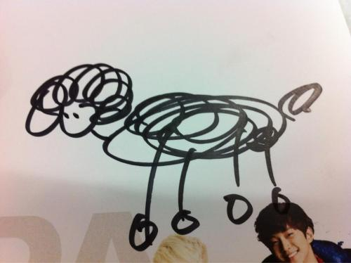 "Jun.K's drawing of Audrey from yesterday's Nepa fansign event via ayachan0809Translation of her tweet: ""Minjun gave me a drawing of Audrey haha after drawing it, he laughed and apologized saying 'I'm sorry'"""
