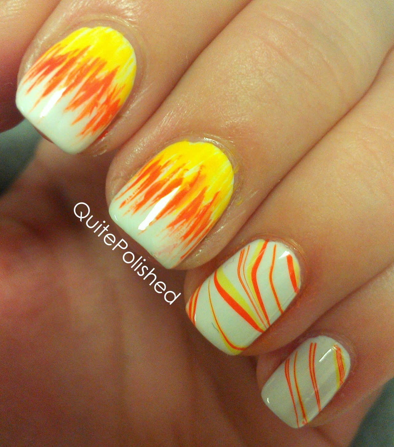 quitepolished:  I wasn't really digging how the candy corn came out, so I went with something a bit more abstract. I really like the contrast between the brushstrokes and the water marble.
