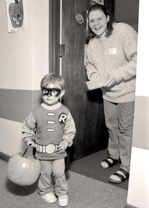A young Robin visits Marquette University's Cobeen Hall in 1995 for Halloween trick-or-treating.Source: Marquette University Archives