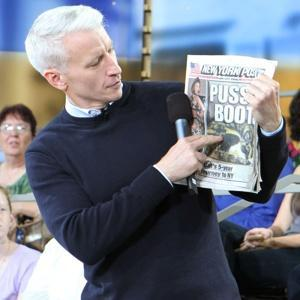 anderson cooper pointing at newspaper.