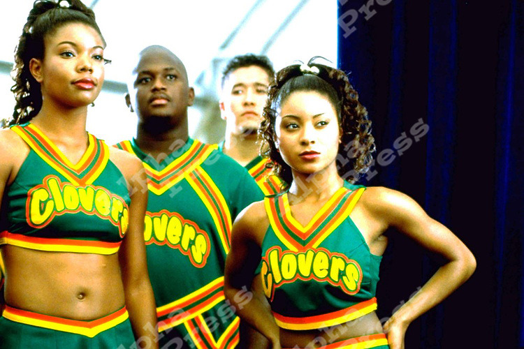 fuckyeahfeminists:   Natina Reed (the girl on the far right) was a member of the Left Eye founded R&B group, Blaque. But most remember her from Bring It On, as one of the Clover cheerleaders.  She was killed yesterday during a hit & run while walking across a street in Atlanta. R.I.P. Natina Reed :(   She wasn't killed during a hit and run. She was hit by a car, but the driver stayed at the scene. Associated Press says:   The Gwinnett County Police Department said in a news release Sunday that the 32-year-old Reed was hit late Friday while in the roadway at an intersection on U.S. 29 near Lilburn.   Police say the driver called 911 for help, and someone tried to revive Reed on the scene. She was later pronounced dead at Gwinnett Medical Center.   It's unclear why Reed was in the road. Police say the driver wasn't at fault and won't be charged.