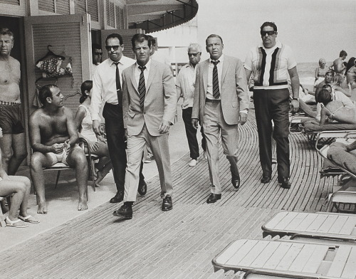 1968 Frank Sinatra and his bodyguards in Miami Beach | Photographer Terry O'Neill shot Ol' Blue Eyes and his muscle, including an identically-dressed stand in, while Sinatra was filming Lady In Cement co-starring sexpot Raquel Welch. Via