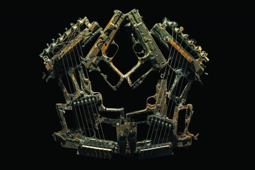 Pedro Reyes: Imagine  Imagine is a set of 50 musical instruments fabricated out of destroyed weapons – revolvers, shot-guns, machine-guns, etc. This work is a progression of Palas por Pistolas (2008), where 1527 weapons were melted and made into the same number of shovels to plant 1527 trees. In April this year I got a call from the government who had learned about Palas por Pistolas, they told me a public destruction of weapons was to take place in Ciudad Juarez and asked me if I was interested in keeping the metal, which would otherwise have been buried as usual. I accepted the material but I wanted to do something new this time. 6700 weapons, cut into parts and rendered useless, were given to me and I set out to make them into instruments. A group of 6 musicians worked for 2 weeks shoulder-to-shoulder turning these agents of death into instruments of life. The task was challenging but they succeeded in extracting sounds, from percussion to wind and string. It's difficult to explain but the transformation was more than physical. It's important to consider that many lives were taken with these weapons; as if a sort of exorcism was taking place the music expelled the demons they held, as well as being a requiem for lives lost.