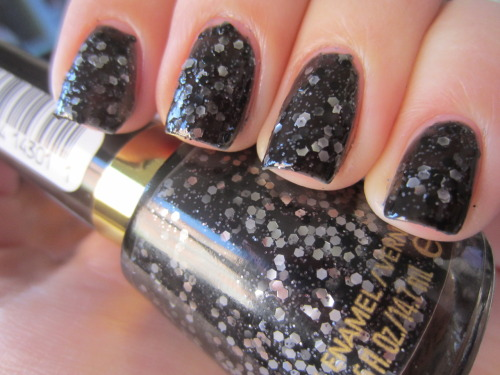 "revlon ""sparkle aplenty"" when i first got this i thought it wasn't that unique.  it looks like opi's metallic 4 life.  but once i applied it its so unique! its a dark charcoal jelly base with MATTE silver and black chunky glitter and silver microglitter.  omg matte glitter? and matte black glitter?? so unique! this is 2 coats.  i've tried layering it but its way to opaque to be layered, which sucks because i wish the black pieces came out more"