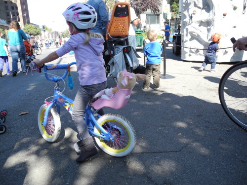 taking her stuffed animal friend for a ride! @sunday streets berkeley, 14.10.12.
