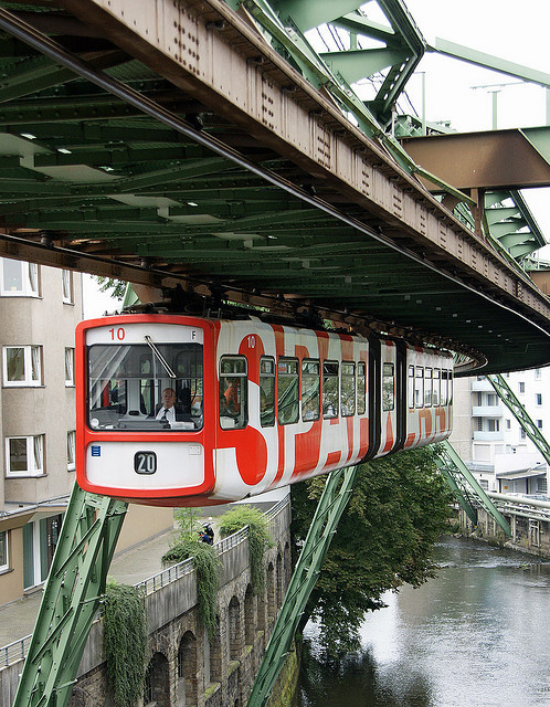 visitheworld:  Wuppertal Schwebebahn or Wuppertal Floating Tram, a suspension railway in Wuppertal, Germany (by Neil Pulling).   I'm going to be in Germany next month. Maybe worth going out of my way to ride on this?