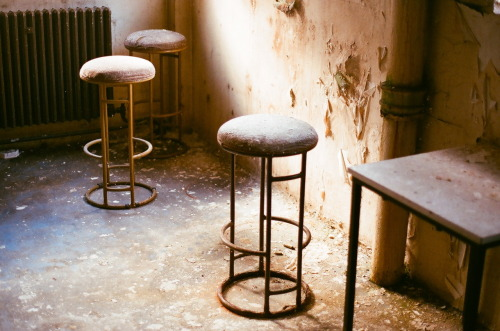 Stools left behind when the building was abandoned 6 years ago