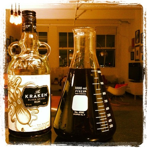 Kraken spiced black run & pomegranate cocktail served in a laboratory flask, 500 Tasty Sandwiches test kitchen