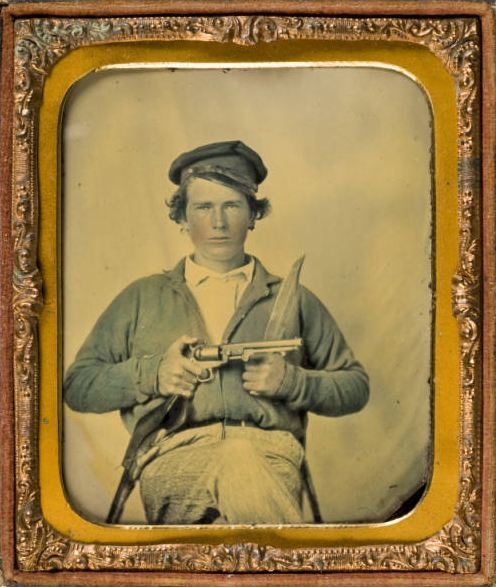 ca. 1861, [ambrotype portrait of Confederate Private Japhet Collins, brandishing a pistol and a knife] via Southern Methodist Central University Libraries, DeGolyer Library, Lawrence T. Jones III Texas Photographs