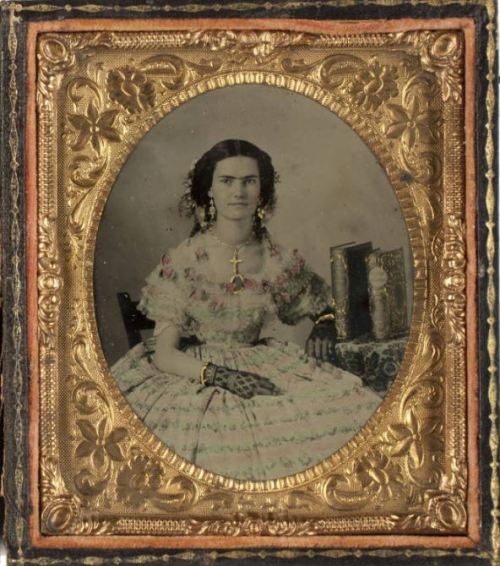 tuesday-johnson:  ca. 1860, [ambrotype portrait of a beautiful young woman wearing an exquisitely detailed dress, black lace gloves, and gold jewelry with applied gilding] via Southern Methodist University, Central University Libraries, DeGolyer Library, Lawrence T. Jones III Texas photography collection