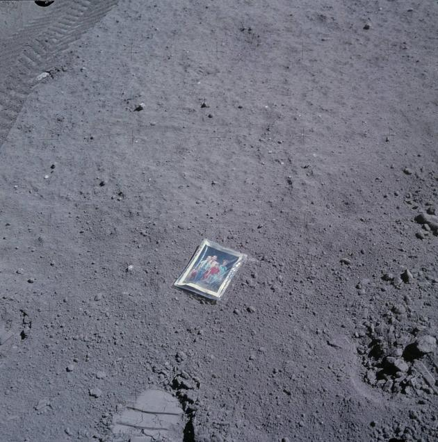 sciencecenter:  Astronaut Charles Duke left his family picture on the moon before departing, as part of the Apollo 16 mission.  And prior to leaving this photo, he went down in history for collecting the largest and heaviest lunar rock ever brought back to Earth: Big Muley. It was a hilariously awkward feat, and quite a dangerous one at that. It's captured here on video: