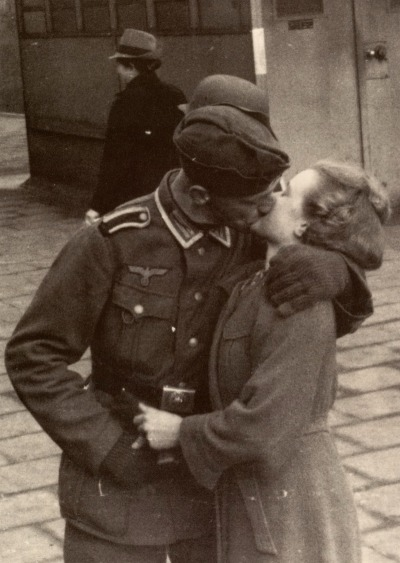 mademoiselle-lolita:  allaboutthepast:  A soldier grabs a last minute goodbye kiss from his sweetheart, 1940s    ♡ light of my life, fire of my loins ♡