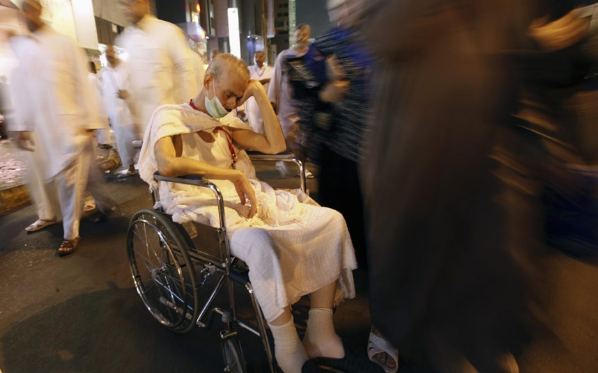 اللهم تقبل حجه A Muslim pilgrim waits in a wheelchair after performing early dawn prayers in an area near the Grand MosquePicture: REUTERS/Amr Abdallah Dalsh