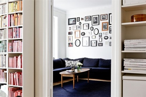 Source: My Scandinavian Home Great shot! Love how the bookcase frames the doorway and the sneak peak into the next room. The different picture frames create a focal point and look uber cool!