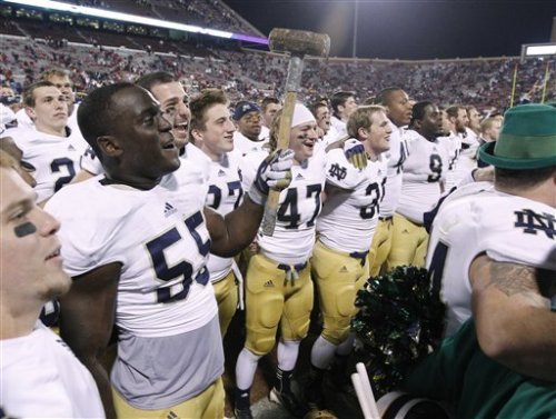 Notre Dame linebacker Prince Shembo wields a sledgehammer as he celebrates with fans following a 30-13 victory over Oklahoma in an NCAA college football game in Norman, Okla., Saturday, Oct. 27, 2012. (Credit: AP)