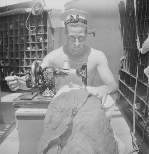 British sailor on the HMS Alacantara, en route to the Middle East, using a sewing machine to repair a signal flag. Taken by Cecil Beaton in 1942 and now exhibited in the IWM's Cecil Beaton: Theatre of War exhibition.  My personal highlight from the exhibition. IBx