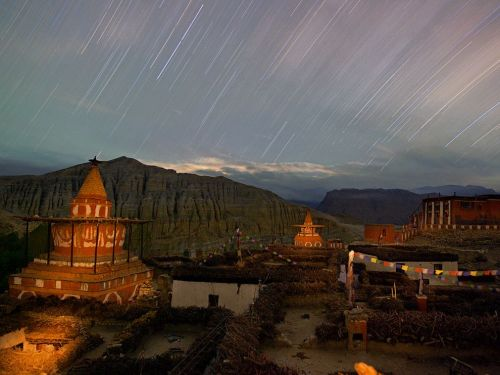 nationalgeographicmagazine:  Mustang Province, Nepal Photograph by Cory Richards, National GeographicDusk falls over the temples and homes of Tsarang, once the region's most important town. In Mustang, where the centuries have not disrupted the traditional rhythm of life, the caves offer clues to a time when the remote Himalayan kingdom was a hub linking Tibet to the rest of the world.  Download Wallpaper (1600 x 1200 pixels)  Great picture    (via TumbleOn)